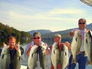 Four Men Holding Fish Caught in Helen Georgia